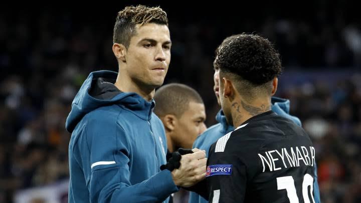 Neymar and Ronaldo shake hands during a match.