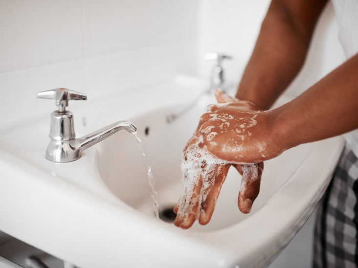 Man washing his hands in the bathroom at home