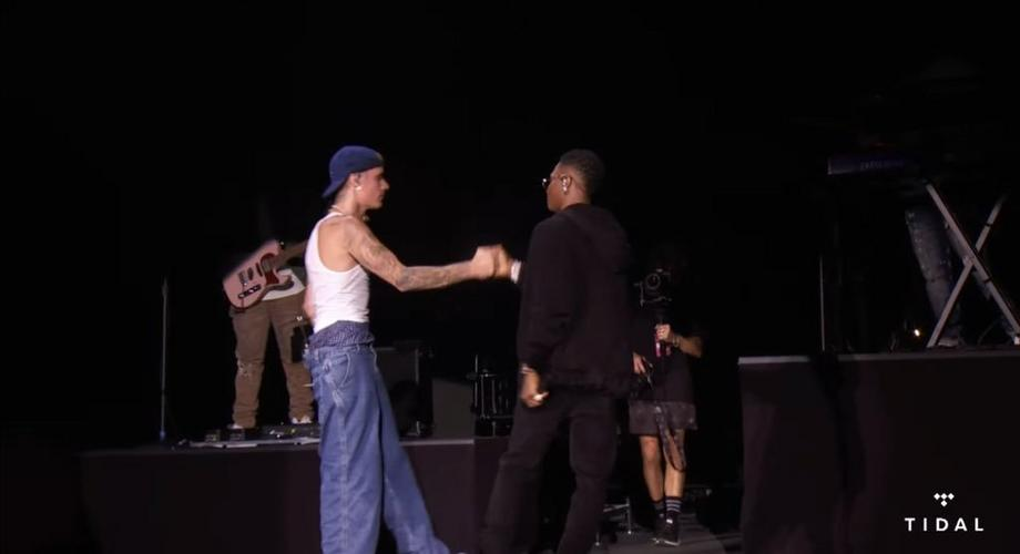 Wizkid performs on stage with Justin Bieber